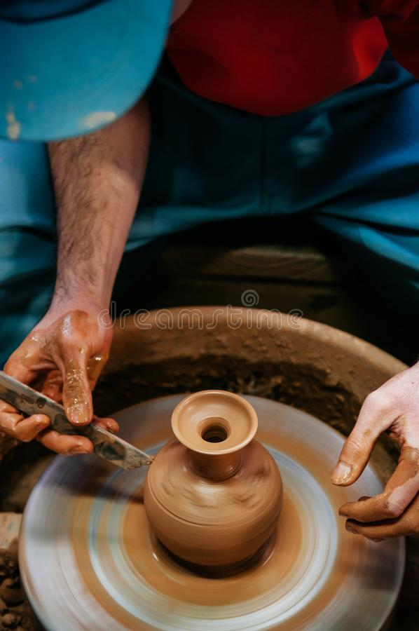 Man making pottery art, clay work close up hands shot stock photography