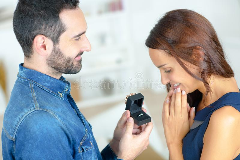 Man making propose wiith wedding ring stock photo