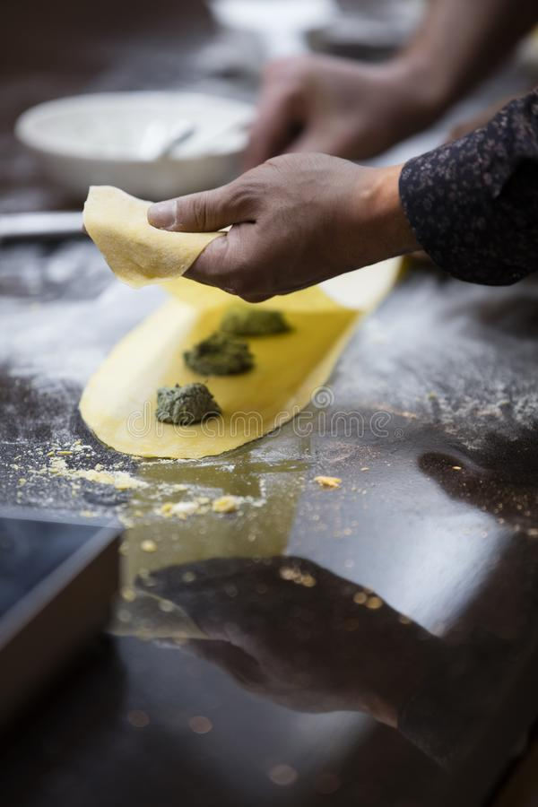 Man making ravioli. Italian cuisine and gluten-free royalty free stock photos