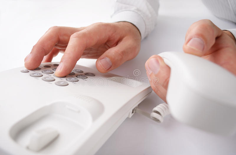 Man making a telephone call on a landline royalty free stock photography