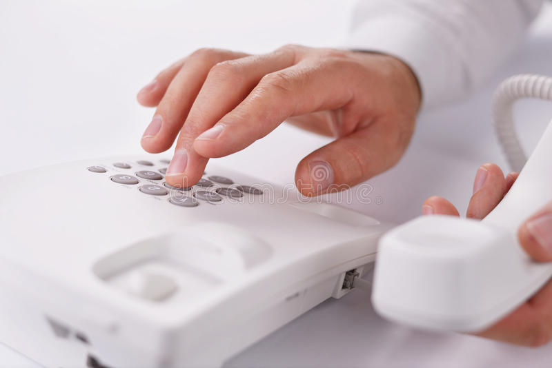 Download Man Making A Telephone Call On A Landline Stock Photo - Image of instrument, conversation: 33910516