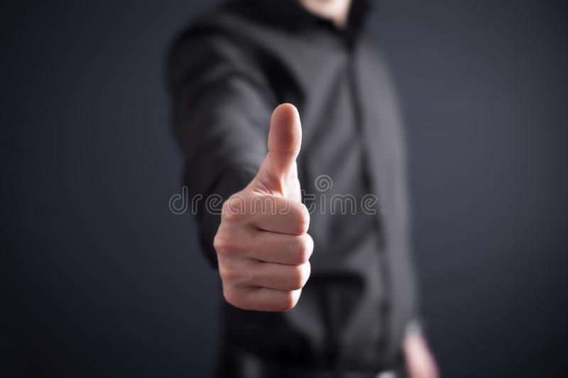 Man making a thumbs up sign royalty free stock images