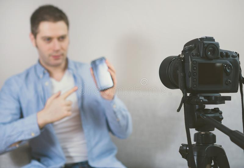 Man making video blog about mobile phones. stock photos