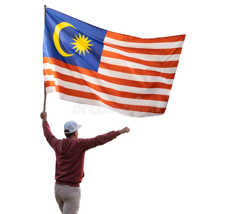 Man with malaysian flag isolated over white. Background. shoot from the back. malaysia independence day royalty free stock images