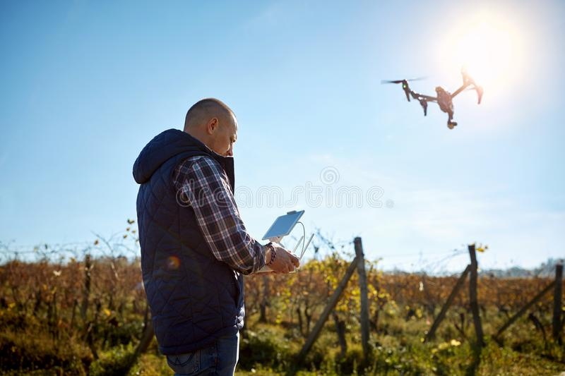 Man manage drone at sky stock images