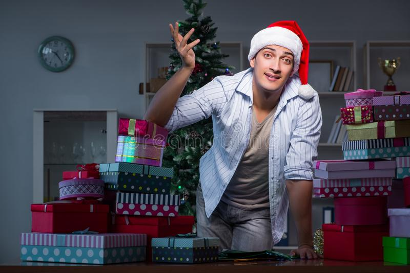 The man with many christmas gifts in boxes. Man with many christmas gifts in boxes stock image