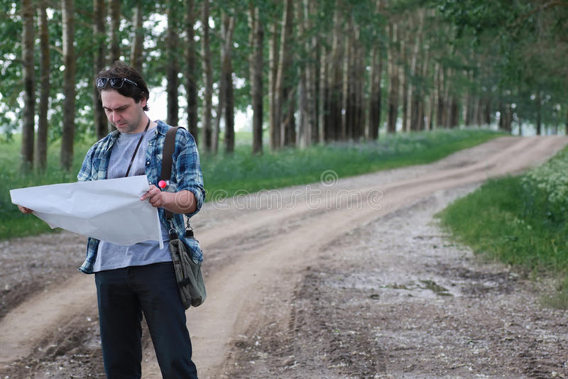 Man with map in a field stock images