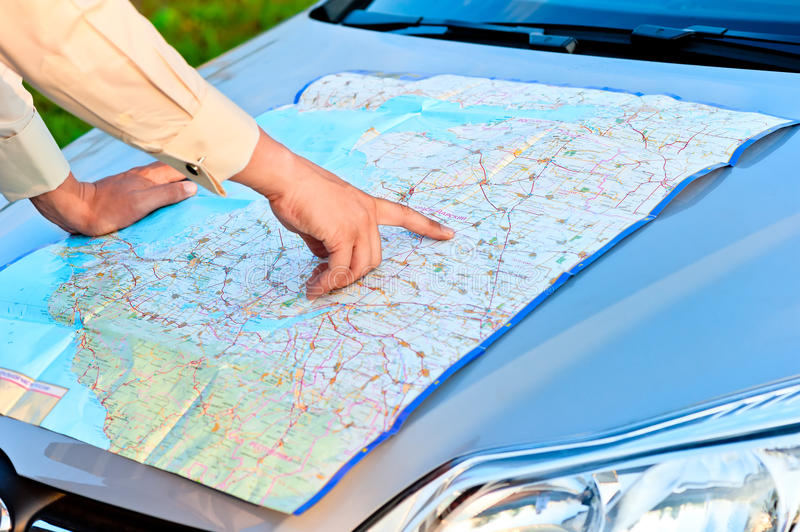 Man on map focuses on the area. Man on the map focuses on the area stock image