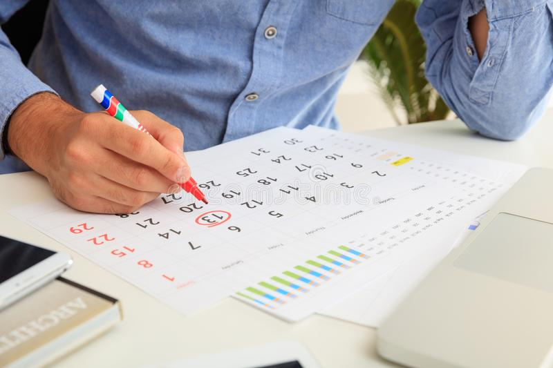 Man marked Friday 13th on the calendar stock photo