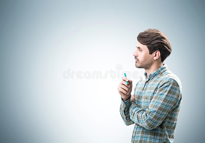 Man with marker near a gray wall royalty free stock images