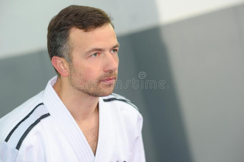 Man in martial arts robe stock image