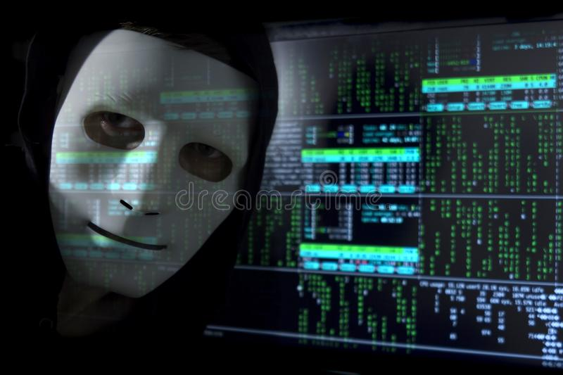 Blure digital. A man-hacker in a mask on the background of binary code. royalty free stock images