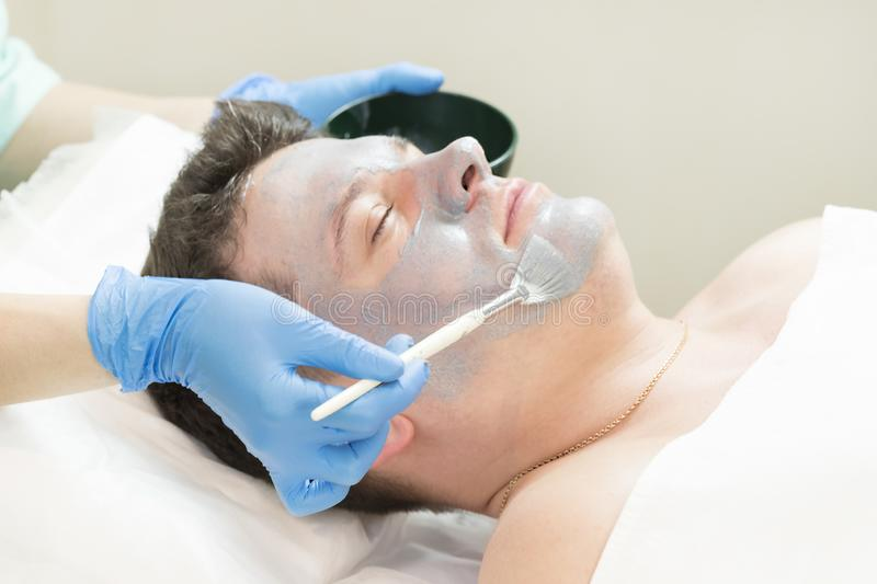 Man in the mask cosmetic procedure royalty free stock images