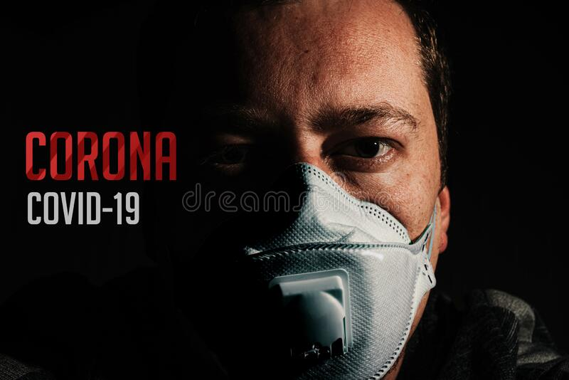 Man with mask n95 for protection form coronavirus. Covid-19 on black background stock images