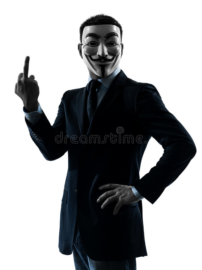 Man masked anonymous group pointing finger silhou. Paris, France - October 30, 2012 : one man dressed and masked as a member of Anonymous underground group royalty free stock image