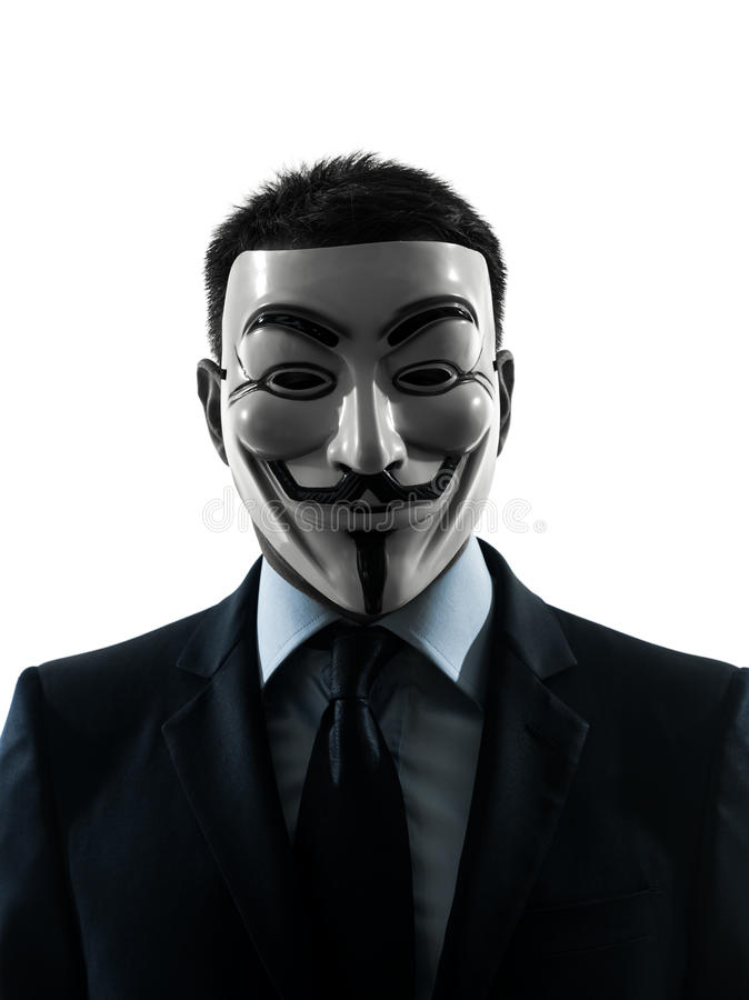 Man masked anonymous group silhouette. PARIS– OCTOBER 30 : one man dressed and masked as a member of Anonymous underground group on October 30, 2012 in stock images