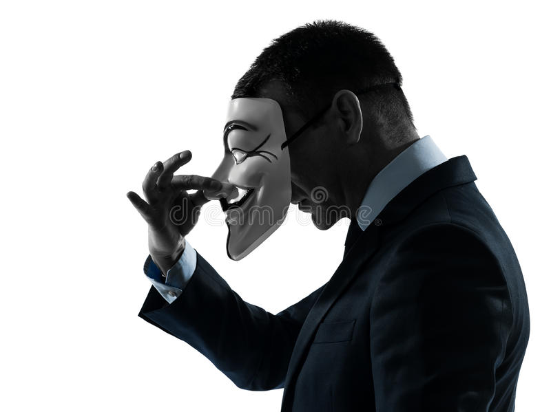Man masked anonymous group silhouette portrait. PARIS– OCTOBER 30 : one man dressed and masked as a member of Anonymous underground group on October 30 royalty free stock photos