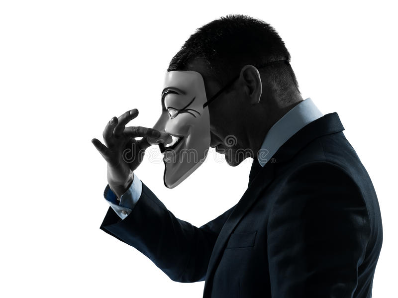 Man masked anonymous group silhouette portrait. Paris, France - October 30, 2012 : one man dressed and masked as a member of Anonymous underground group on stock photos