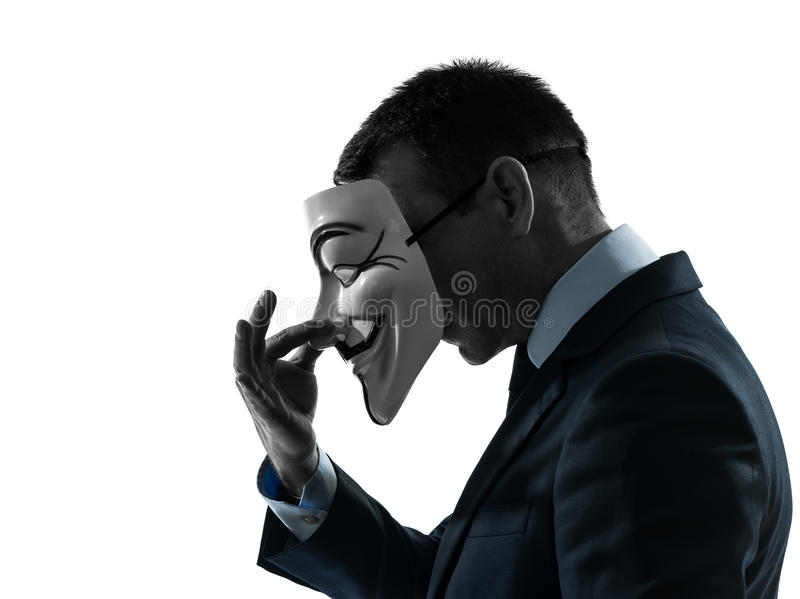 Man masked anonymous group silhouette portrait. PARIS – OCTOBER 30 : one man dressed and masked as a member of Anonymous underground group on October 30 royalty free stock image