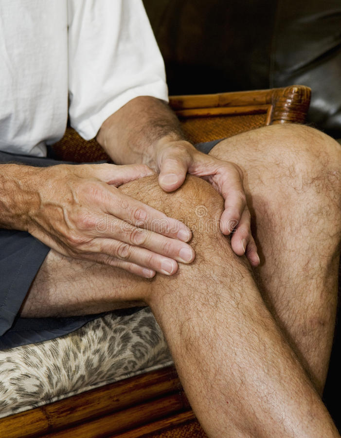 Free Man Massaging Knee Pain_2 Stock Photos - 10777173