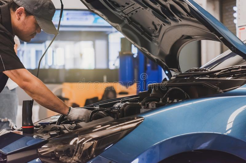 Man mechanic inspection service maintenance car for checking with customer checking engine in garage showroom dealership royalty free stock image