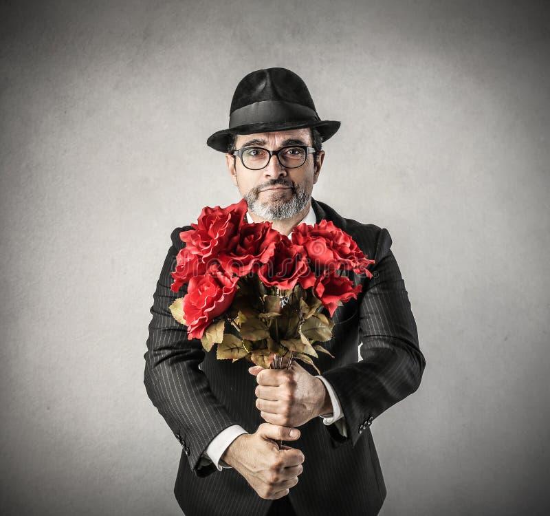 Man med blommor royaltyfria foton