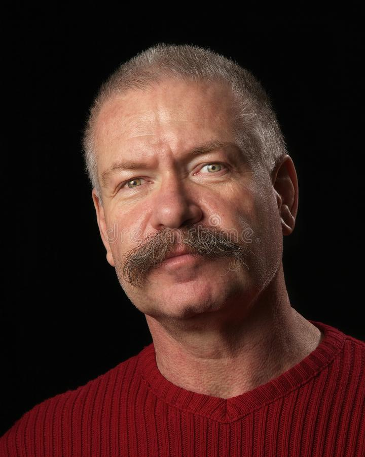 Man med den buskiga moustachen arkivfoton