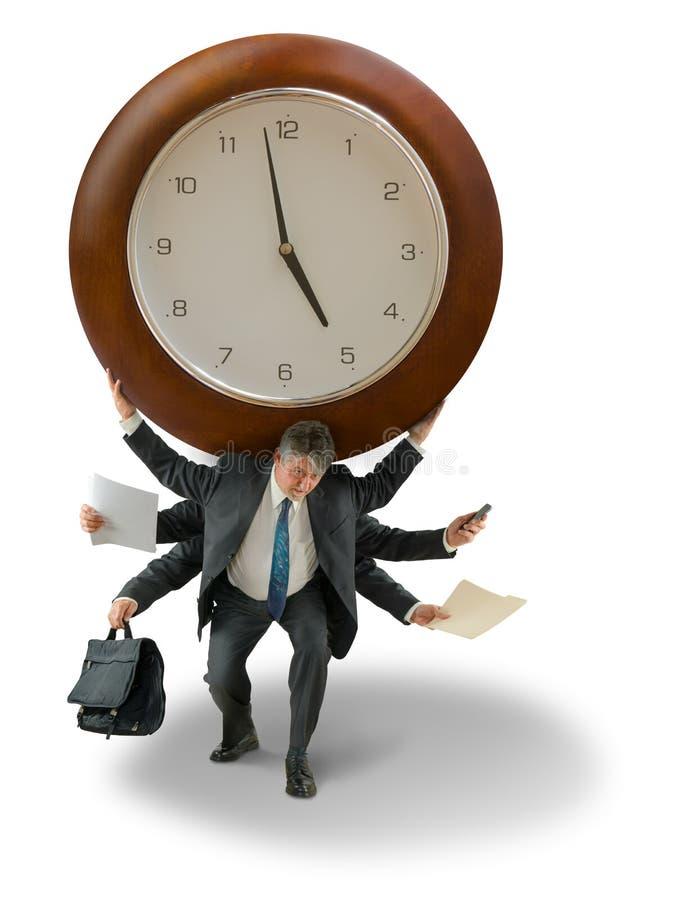 Man med den jätte- klockan på tryck för skuldratidstopptid arkivbild