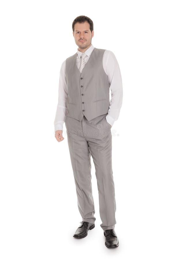 Man med den ljusa gråa dräkten som isoleras på vit bakgrund Affärs- och bröllopbegrepp royaltyfri fotografi