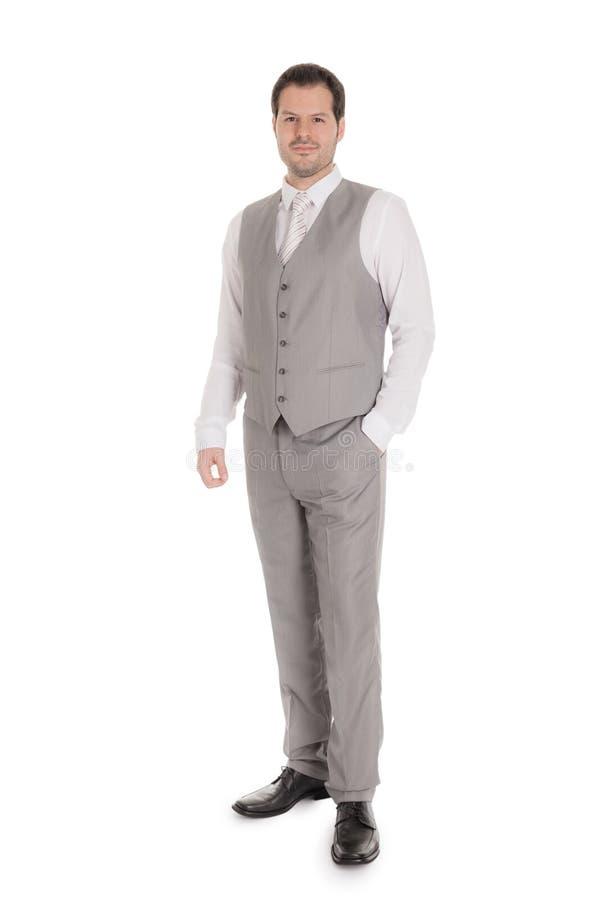 Man med den ljusa gråa dräkten som isoleras på vit bakgrund Affärs- och bröllopbegrepp arkivfoto