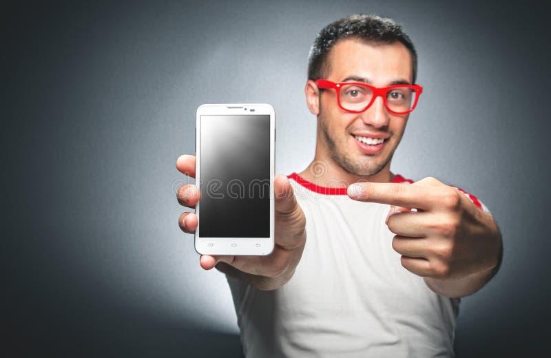 Man med den mobila telefonen royaltyfri foto