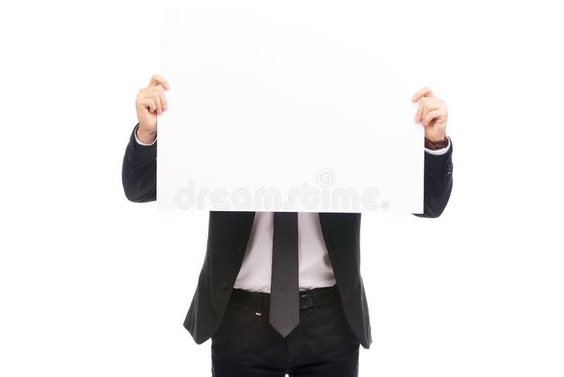 Man med det tomma arket av papper arkivfoton