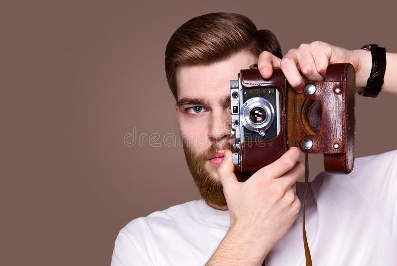 man med en kameramodellhipster arkivbilder