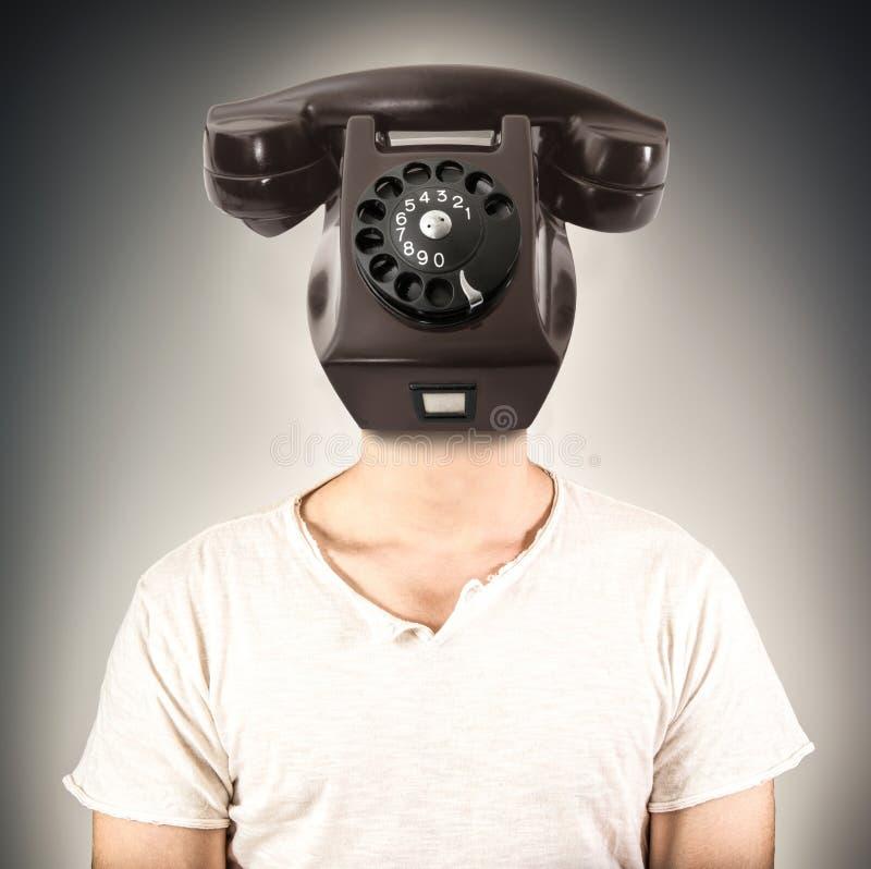 Man med ett telefonhuvud arkivfoton