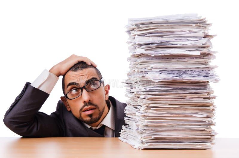 Man med för mycket arbete arkivfoton
