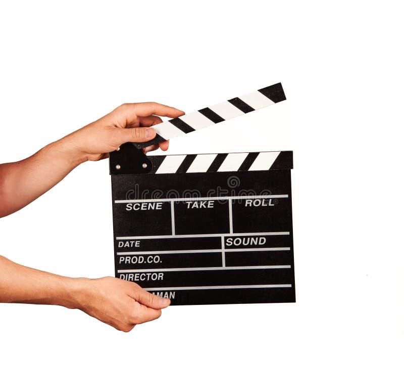 Man med filmclapperen på vit bakgrund royaltyfria bilder
