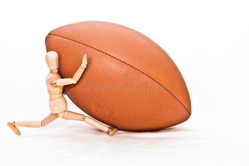 Man med fotboll fotografering för bildbyråer
