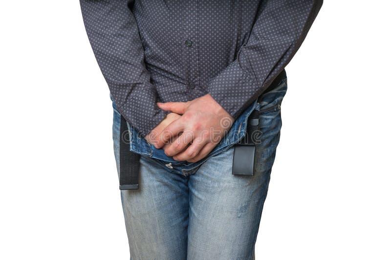 Man med händer som rymmer hans klyka, honom önskar att kissa, inkontinens fotografering för bildbyråer