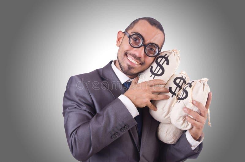 Man med pengarsäckar arkivfoton