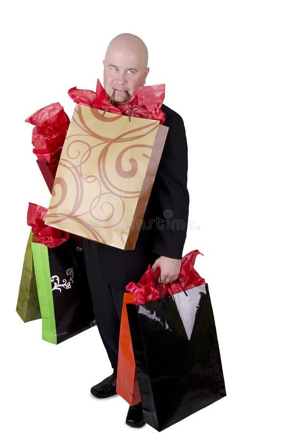 Man med shoppingpåsar arkivfoto