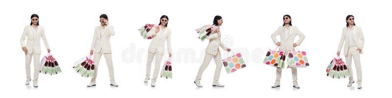 Man med shoppingp?sar som isoleras p? vit fotografering för bildbyråer