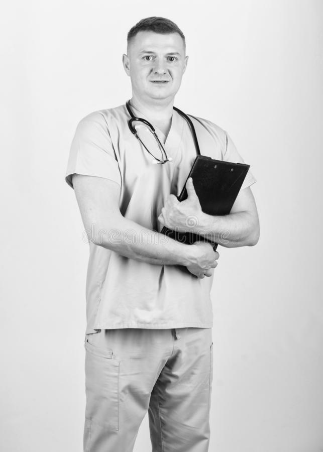 Man in medical uniform. Treatment prescription. nurse laboratory assistant. family doctor. medicine and health. Confident doctor with stethoscope. pediatrician royalty free stock photography