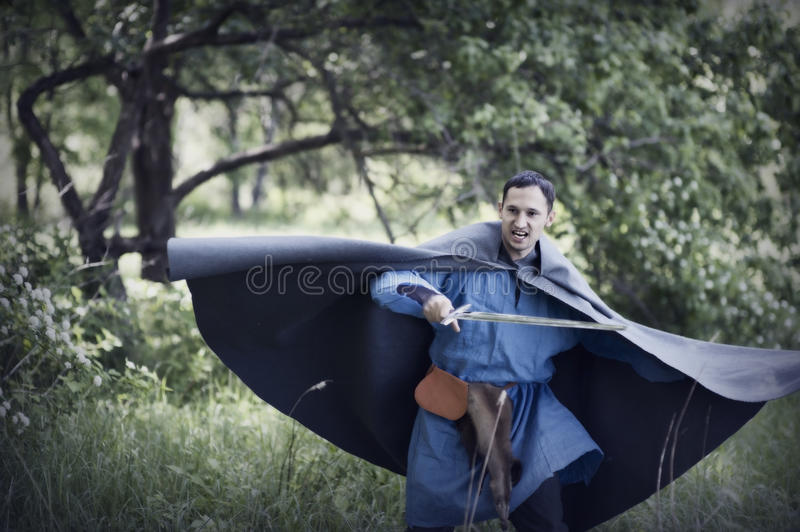 Man With Medieval Sword Stock Photo