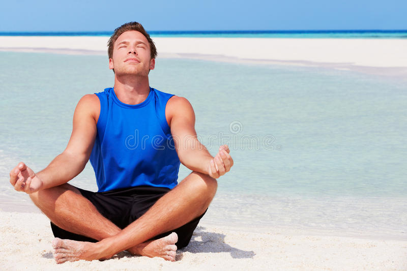Download Man Meditating On Beautiful Beach Stock Photo - Image: 30330172