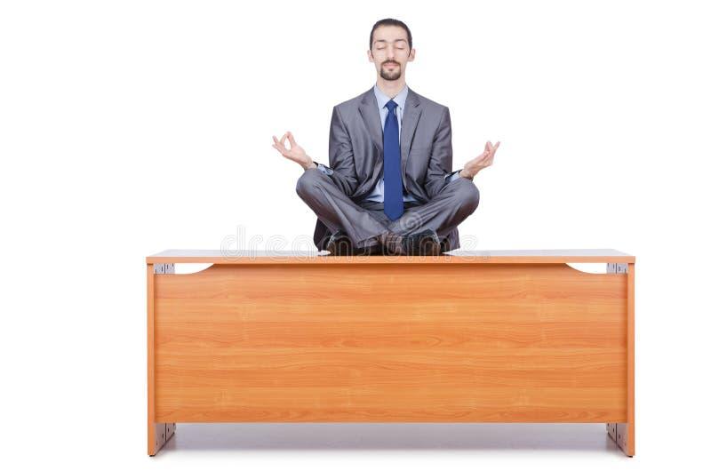Man Meditating On The Desk Stock Photos