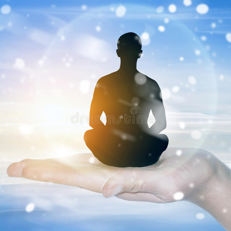 Man meditating in Lotus position stock images