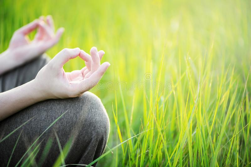 Man meditating outdoor in the park. Healthy and Yoga Concept stock photography