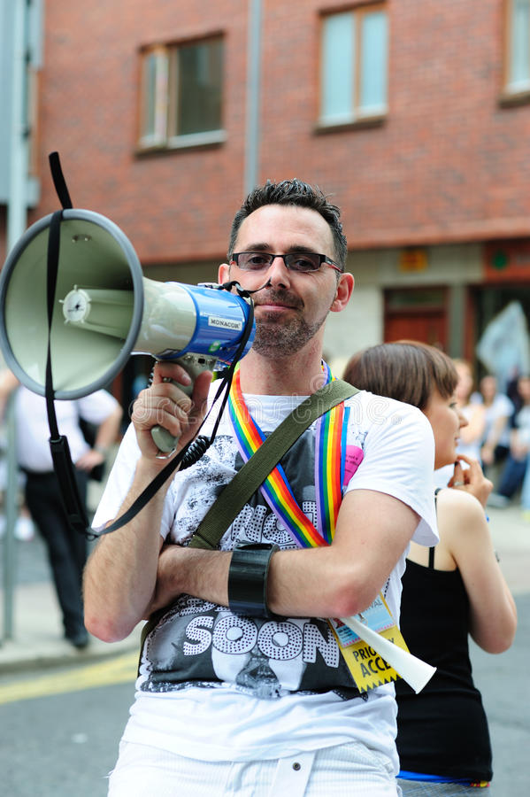 A man with a megaphone at Dublin LGBT Pride Parade royalty free stock photography