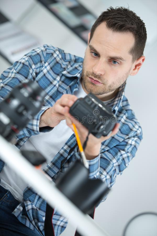 Man mending a camera stock image