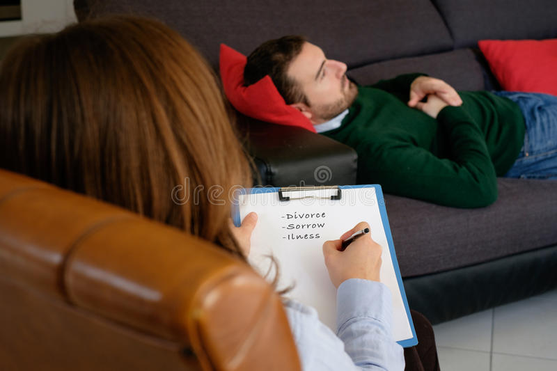 Man with mental health problem in the psychiatrist studio stock images